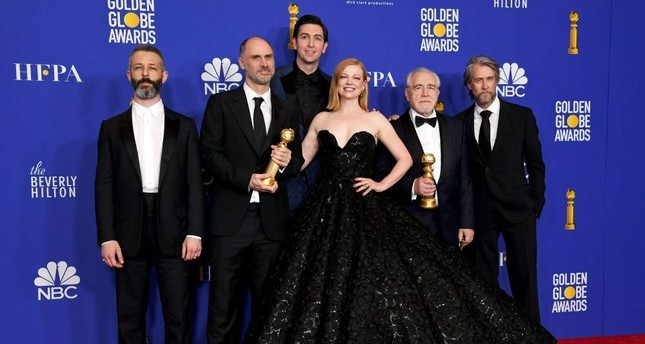 L-R Jeremy Strong, Jesse Armstrong, Nicholas Braun, Sarah Snook, Alan Ruck, and Brian Cox pose with the award for Best Television Series - Drama for Succession during the 77th Annual Golden Globe Awards at The Beverly Hilton Hotel on January 05, 2020 in Beverly Hills, California. AFP Photo