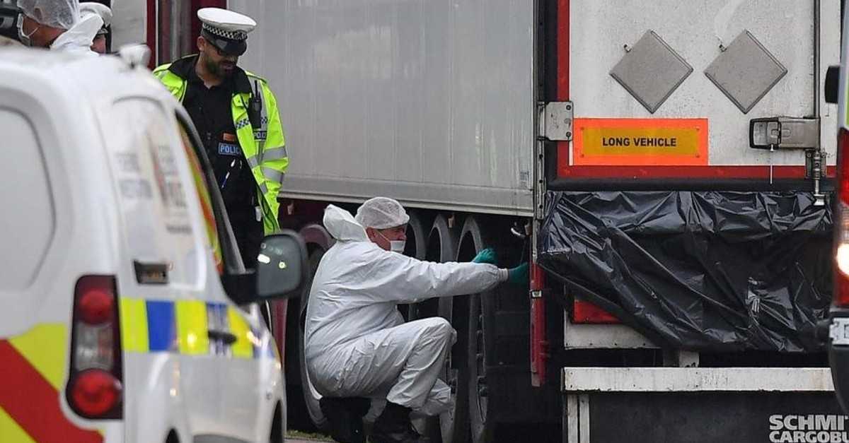 This Oct. 23, 2019, file photo, shows police forensics officers work on a lorry, found to be containing 39 dead bodies, at Waterglade Industrial Park in Grays, east of London. (AFP Photo)