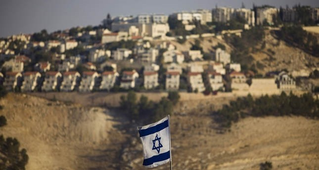 An Israeli flag is seen in front of the illegal Jewish settlement of Maaleh Adumim in West Bank, on the outskirts of Jerusalem, in this 2009 file photo (AP)