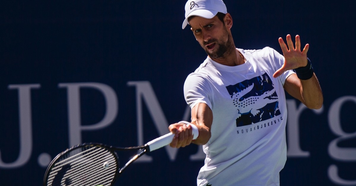 Novak Djokovic returns the ball as he  practices for the U.S. Open tennis tournament, Aug. 24, 2019, in New York.