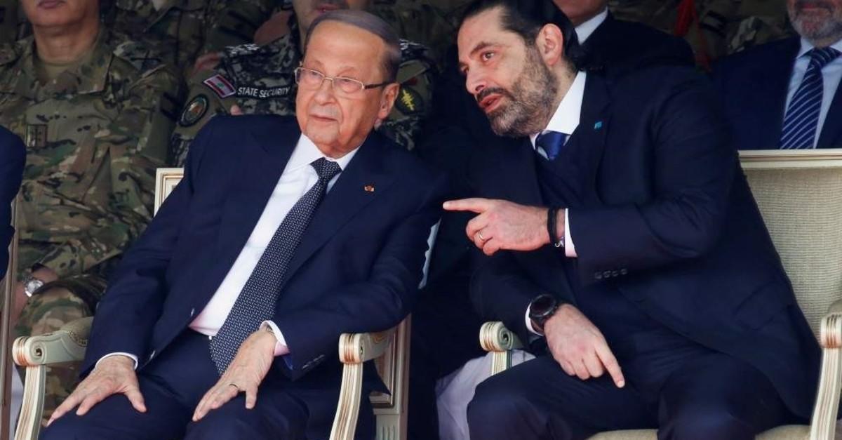 Lebanon's caretaker Prime Minister Saad al-Hariri chats with Lebanon's President Michel Aoun, Yarze, Nov. 22, 2019. (Reuters Photo)