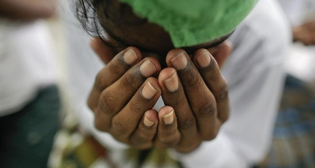 A suspected victim of human trafficking prays at a government shelter in Takua Pa district of Phang Nga October 17, 2014. REUTERS Photo