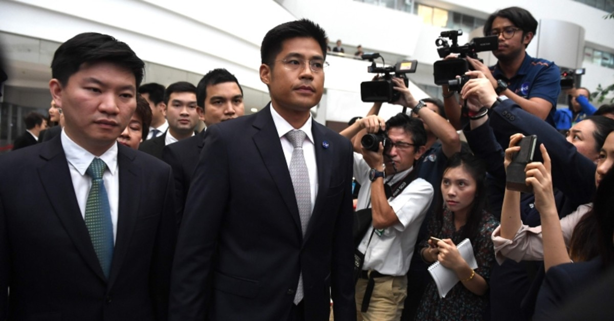Thai Raksa Chart party leader Preechaphol Pongpanich (C) with other officials leaves the Constitutional Court in Bangkok on March 7, 2019, after a court ruling. (AFP Photo)