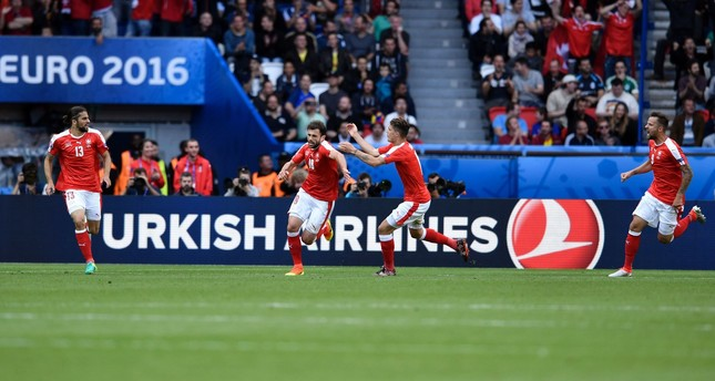 Swiss players celebrate the goal of Switzerland's forward Admir Mehmedi (2nd L) during the Euro 2016 group A football match with Romania. (AFP Photo)