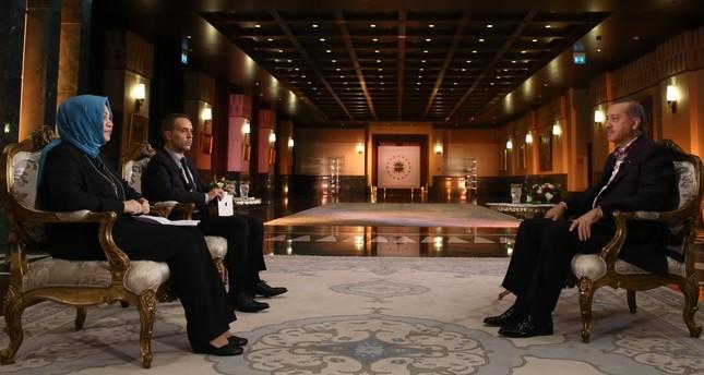 Daily Sabah columnists Hilal Kaplan and Melih Altınok with President Erdoğan at the Presidential Complex.
