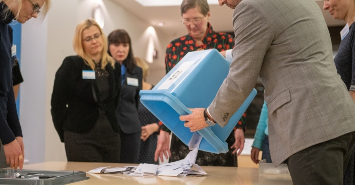 Electoral officials count ballots at a polling station during Estonia's general election in Tallin, on March 3, 2019. (AFP Photo)