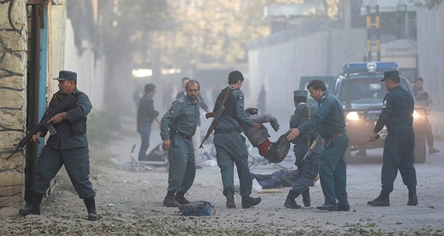 Afghan policemen carry an injuried after a blast in Kabul, Afghanistan, Oct. 31, 2017. (Reuters Photo)