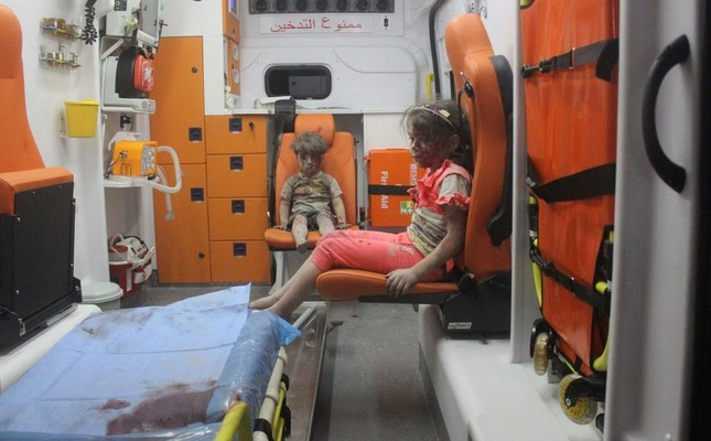 Five-year-old Omran Daqneesh with a bloodied face with his sister in an ambulance. (Reutters Photo)