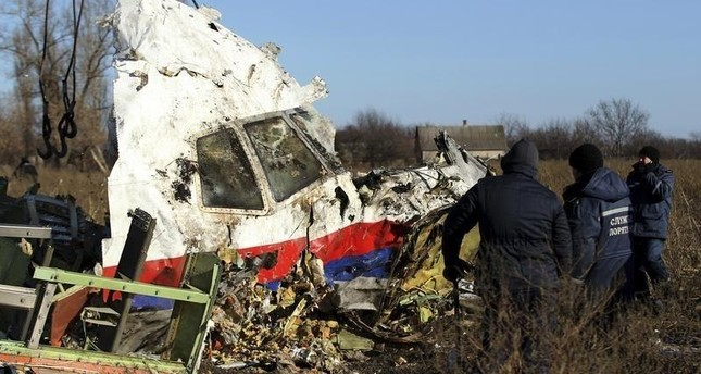 Local workers transport a piece of wreckage from Malaysia Airlines flight MH17 at the site of the plane crash near the village of Hrabove (Grabovo) in Donetsk region, eastern Ukraine November 20, 2014. (Reuters Photo)