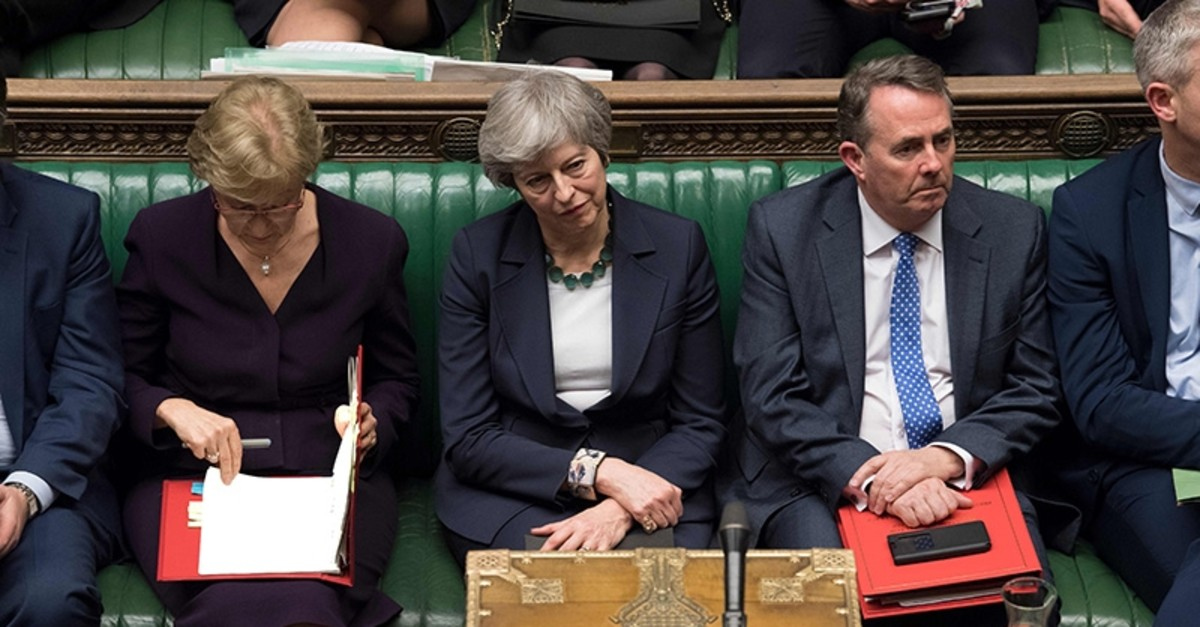 A handout photograph released by the U.K. Parliament on March 13, 2019 shows Britain's Prime Minister Theresa May reacting on the front bench in the House of Commons in London on March 13, 2019. (AFP Photo)