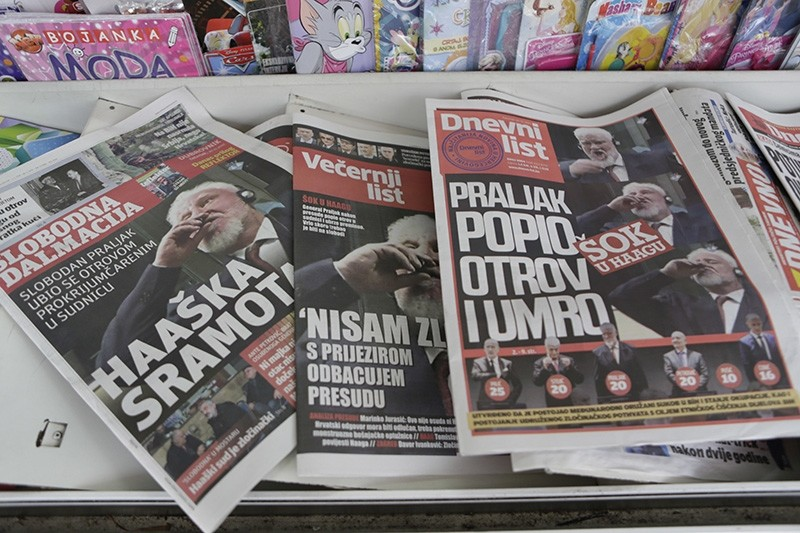 Newspapers on display reporting on Slobodan Praljak, in the southern Bosnian town of Mostar 140 kms south of Sarajevo, Thursday, Nov. 30, 2017. (AP Photo)