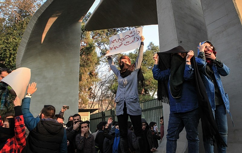 Iranian students clash with riot police during an anti-government protest around the University of Tehran in Tehran, Iran, Dec. 30, 2017. (EPA Photo)