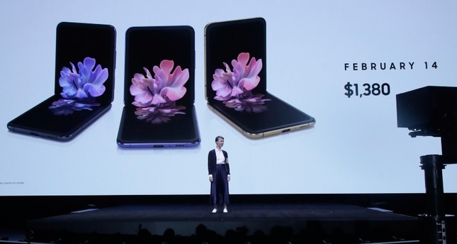 Rebecca Hirst, head of UK Mobile Product Development, speaks in front of photos of Samsung Galaxy Z Flip Phones at the Unpacked 2020 event in San Francisco, Tuesday, Feb. 11, 2020.  AP Photo