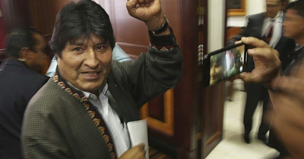 Bolivia's former President Evo Morales pumps his fist after a press conference at a journalists club, Mexico City, Nov. 27, 2019. (AP Photo)