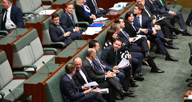 Coalition members vote yes to an amendment on the Marriage Amendment Bill in the House of Representatives at Parliament House in Canberra, Australia, 07 December 2017. (EPA Photo)