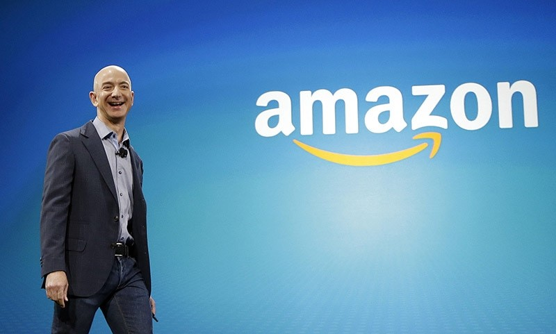 Amazon CEO Jeff Bezos walks onstage for the launch of the new Amazon product. (AP Photo)