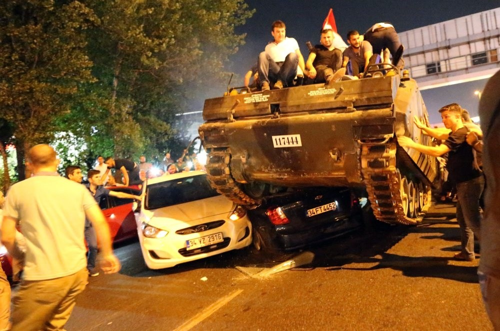 Civilians on a tank captured from putschists in Istanbul on July 15, 2016. Pro-coup troops crushed cars blocking the road in their attempts to take over the city.