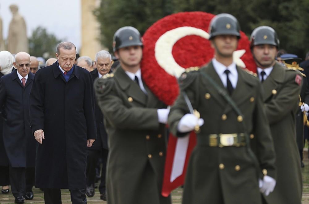 President Recep Tayyip Erdou011fan follows a military honor guard walking to the mausoleum of Mustafa Kemal Atatu00fcrk to lay a wreath, on Republic Day, Ankara, Oct. 29.
