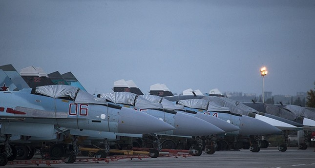 Russian fighter jets and bombers are parked at Hemeimeem air base in Syria, March 4, 2016. (AP)