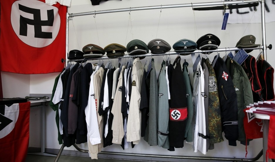 Nazi uniforms and a Swastika flag that were confiscated by the Berlin police during raids against German neo-Nazis are presented to the public during an open day at a police barracks in Berlin, September 7, 2014. (Reuters Photo)