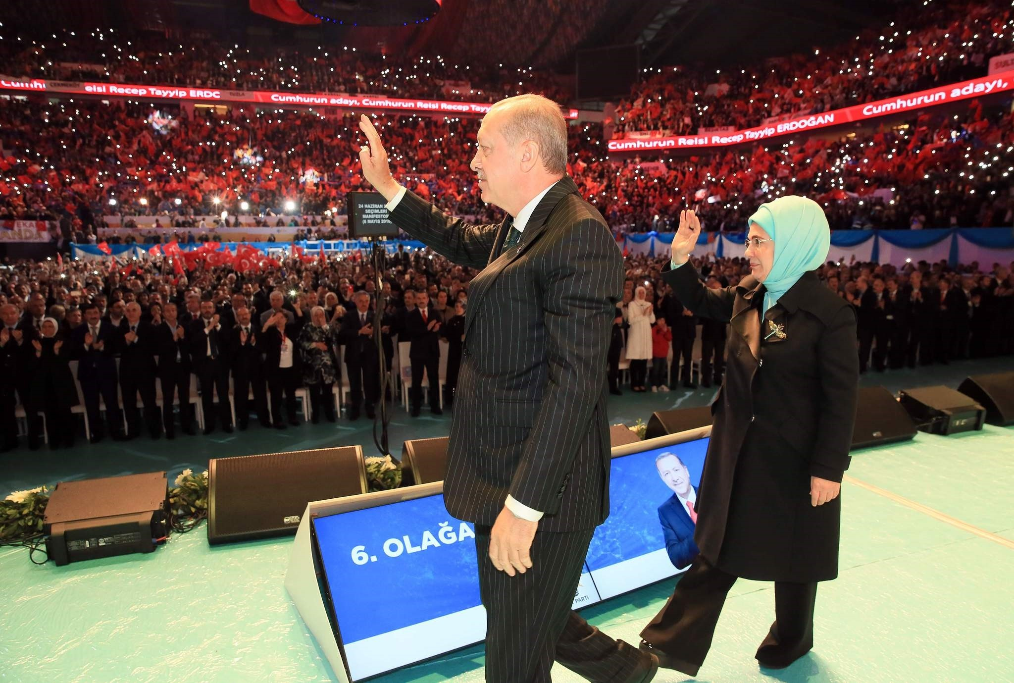 President Recep Tayyip Erdogu0306an and First Lady Emine Erdogu0306an wave to supporters prior to his speech revealing his ruling partyu2019s manifesto ahead of snap elections, in Istanbul, May 6.