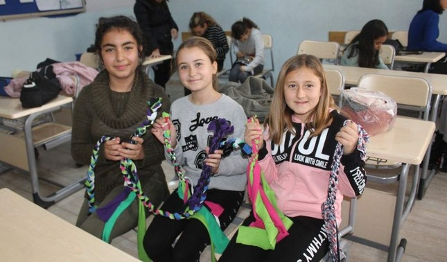 The children had lots of fun while making new toys for the canines. AA Photo