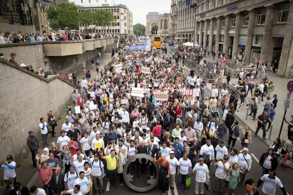 The photo shows people that took part in ,The Not With Us, rally in Cologne, Germany, 17 June.