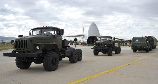 A handout photograph taken and released on July 12, 2019, by the Turkish Defence Ministry shows a Russian military cargo plane carrying S-400 missile defence system from Russia to the Murted military airbase (Defense Ministry Photo)