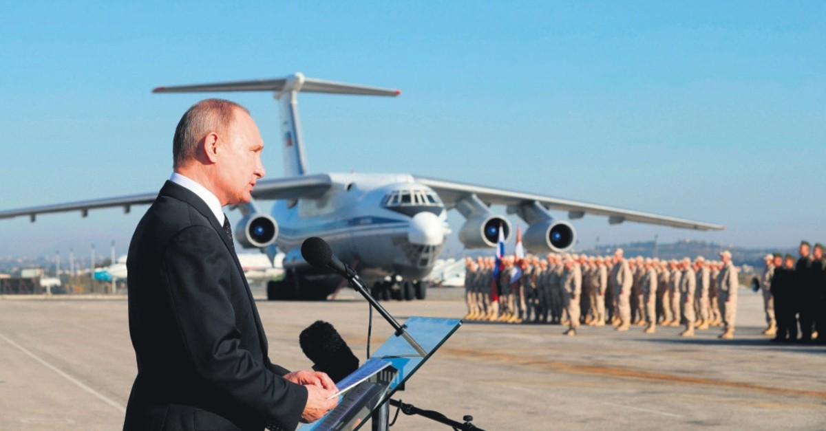 Russian President Vladimir Putin addresses the troops at the Hemeimeem Air Base in Syria, Dec. 12, 2017.