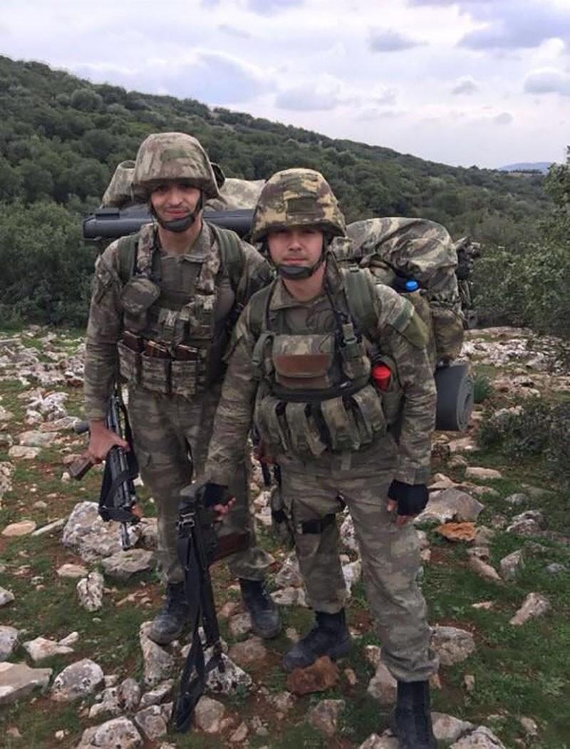 Infantry First Lieutenant Ou011fuz Kaan Usta (R).