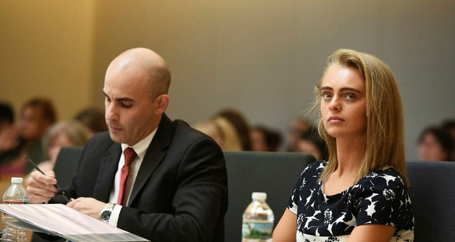 Defense Attorney makes notes as defendant Michelle Carter listens with attorney Joseph Cataldo (not shown) during her trial at Taunton Juvenile Court in Taunton, Mass., Monday, June 12, 2017. (The Boston Herald via AP)