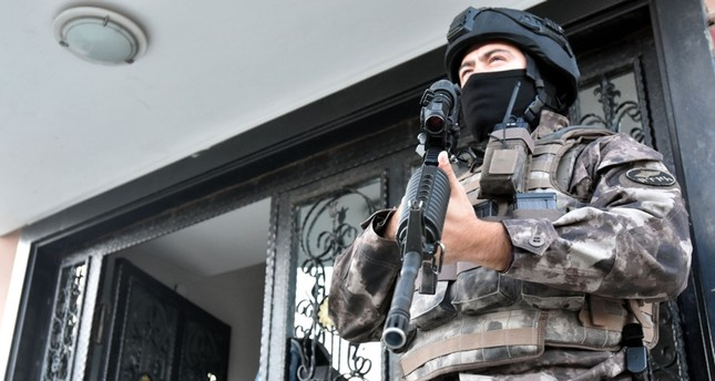 A special operations police stands guard outside a house where an operation is underway against FETÖ members DHA File Photo