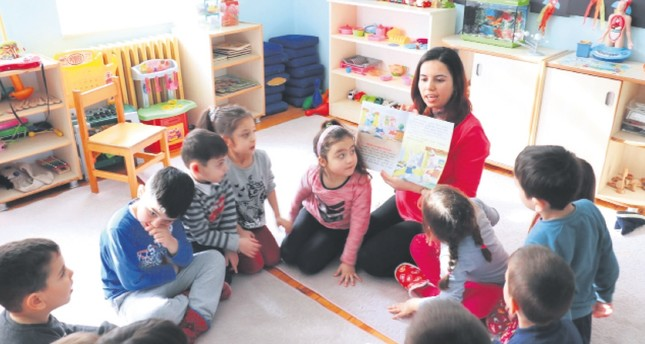 Nurten Akkuş (C-R) is praised for two projects she developed for students.