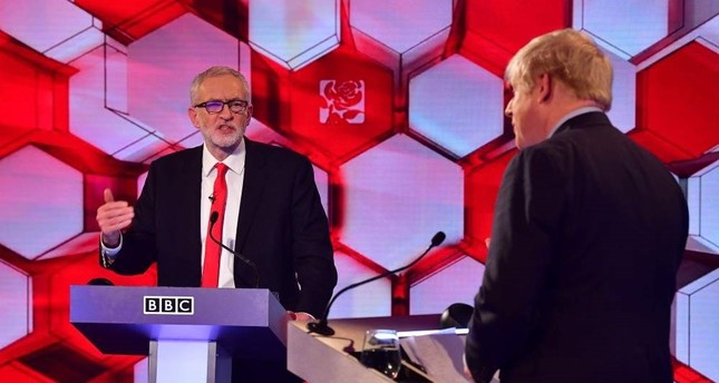 Britain's Prime Minister Boris Johnson R and Britain's main opposition Labour Party leader Jeremy Corbyn participate in the BBC Prime Ministerial leaders debate, at the studio in Maidstone, Kent, Dec. 6, 2019. AFP Photo