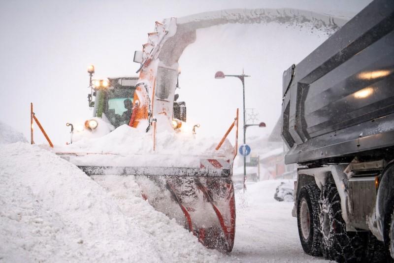 A rotary snow plough cleans a road during heavy snowfall in Obertauern, Austria, Jan. 5,  2019 (EPA Photo)