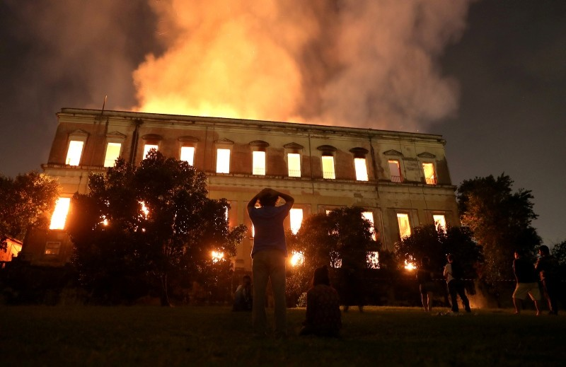 People watch as a fire burns at the National Museum of Brazil in Rio de Janeiro, Brazil September 2, 2018. (Reuters Photo)