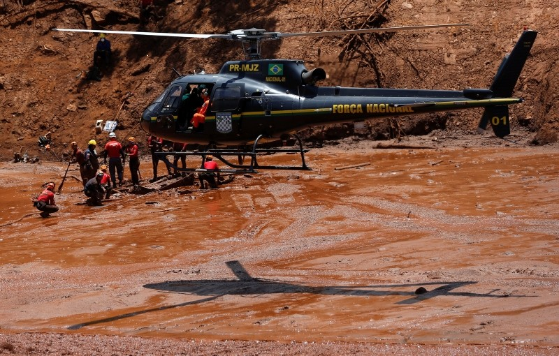 Rescue workers search for victims of a collapsed tailings dam owned by Brazilian mining company Vale SA. (Reuters Photo)