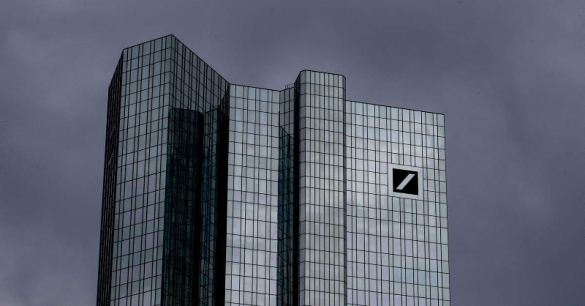Dark clouds cover the sky over the headquarter of Deutsche Bank in Frankfurt, Germany, Sunday, July 7, 2019. (AP Photo)