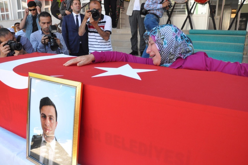 The funeral of Necmettin Yu0131lmaz, 23, was a teacher in u015eanlu0131urfa before he was kidnapped and killed by the PKK.