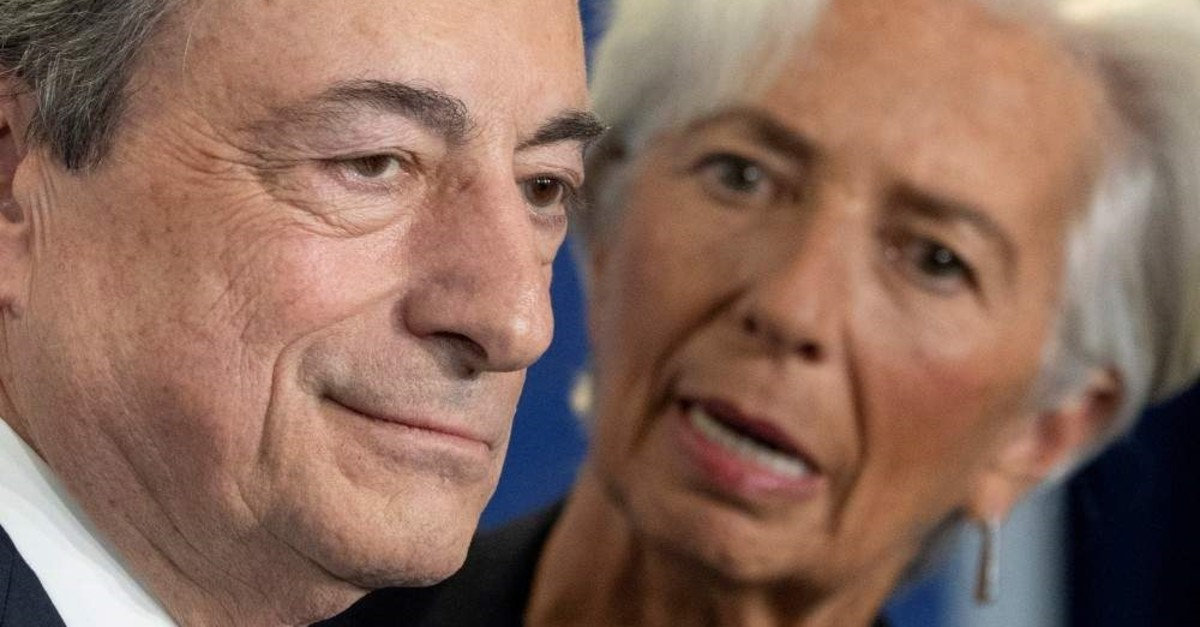 Christine Lagarde, President-designate of the European Central Bank talks to ECB's outgoing President Mario Draghi in Frankfurt, Germany, Oct. 28, 2019.