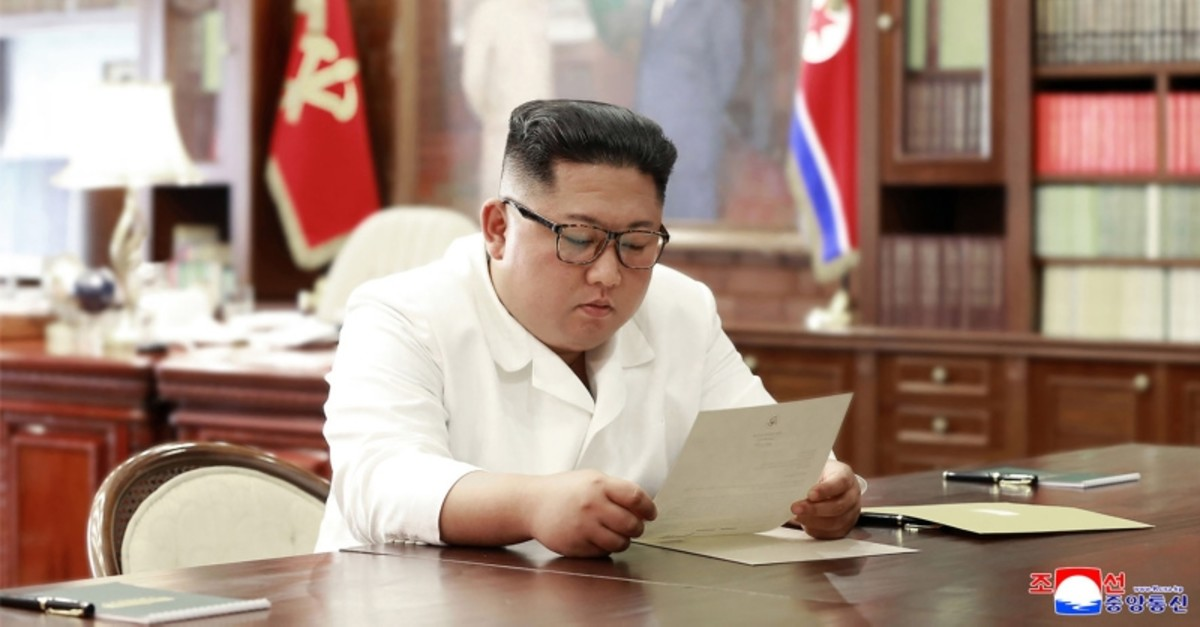 This undated and unlocated picture released from North Korea's official Korean Central News Agency (KCNA)on June 23, 2019 shows North Korean leader Kim Jong Un reading a personal letter from U.S. President Donald Trump. (AFP Photo)