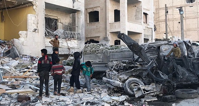 People look at the damage in the aftermath of an explosion in an opposition-held area of the northwestern Syrian city of Idlib on Jan. 8, 2018. (AFP Photo)
