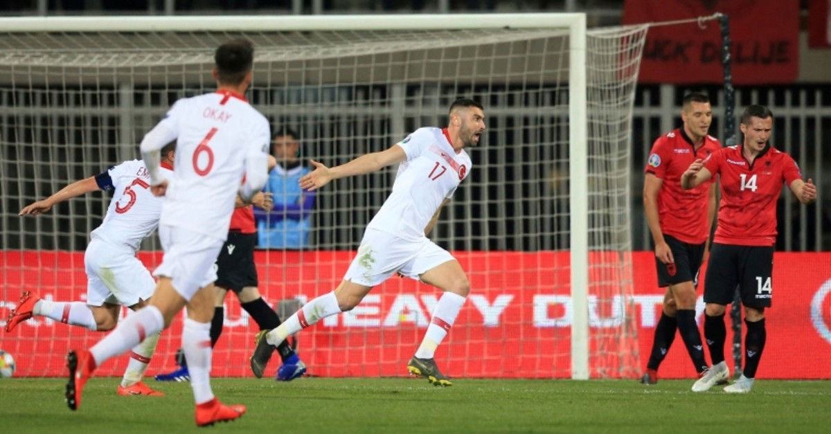 Turkey's forward Burak Yu0131lmaz celebrates after scoring the opening goal of his team during the Euro 2020 group H qualifying soccer match between Albania and Turkey at Loro Borici stadium, in Shkoder, Albania, Friday, March 22, 2019. (AP Photo)