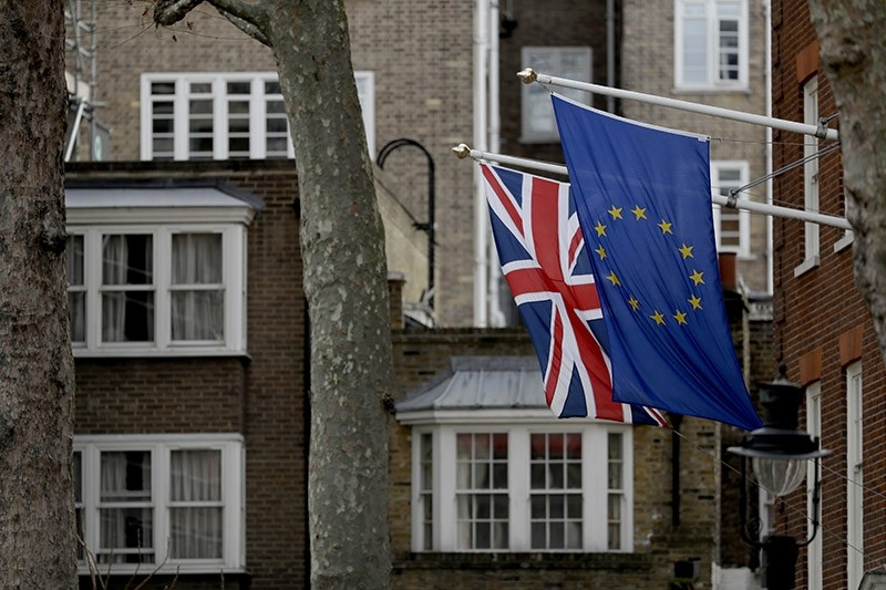 A European and British Union flags hang outside Europe House, the European Parliament's British offices, in London, Tuesday, March 14, 2017. (AP Photo)