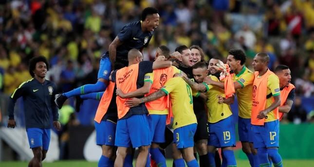 Brazil's Gabriel Jesus celebrates scoring their second goal with team mates (Reuters Photo)