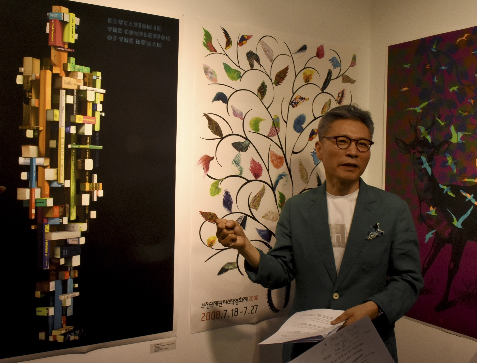 Korean graphic artist Byoungil Sun speaks on a work at the exhibition.