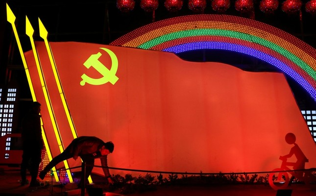 Men check on a light installation in the shape of the party flag of the Communist Party of China set up to celebrate the upcoming Chinese Lunar New Year, in Jining, Shandong province, China, Jan. 29, 2019.
