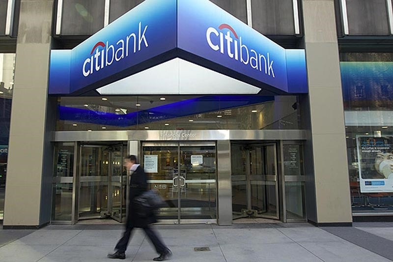 A pedestrian walks past a Citibank branch in the ground floor of Citigroup Inc. headquarters in New York, U.S., on Tuesday, March 8, 2011. (Bloomberg Photo)