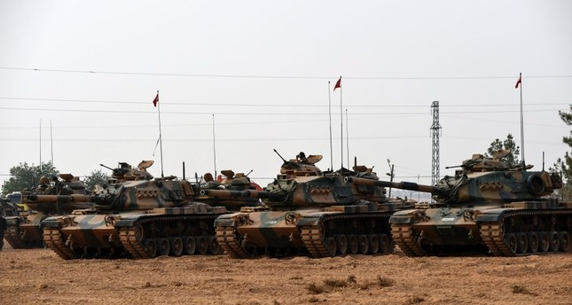 Turkish Army tanks standing in the southern region of Gaziantep, on August 25, 2016, just before the start of Operation Euphrates Shield, to clear Turkey's southern border of Daesh.