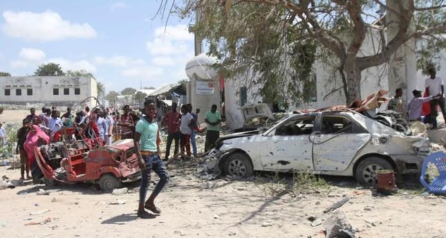 People gather around vehicles destroyed by explosion that hit Somalia's capital Mogadishu, 02 September 2018. (EPA Photo)